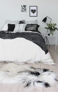 I find black and white to be a perfect color combination for the bedroom. Sure, it may not offer the room the warm glow that others colors such as beige, brown