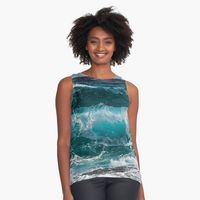Sleeveless top with waves rising and breaking as they approach the shore. The foamy, choppy sea is all shades of turquoise green.