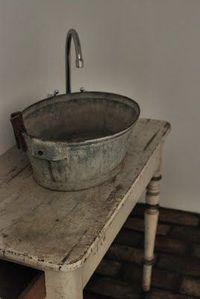 Could be fun to make bathroom in attic very basic with a galvanized bucket sink on an old table. Rustic chic decor in the most underdone way.