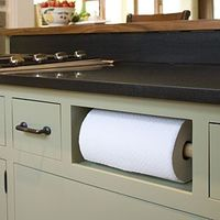 remove fake drawer, and put in paper towels where kids can easily access them (and you don't loose counter space or clutter cabinet).