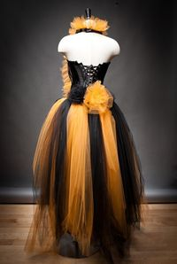 Custom Size Orange and Black Feather Burlesque Corset Witch costume with Hat available in sizes small through 6xl. $499.00, via Etsy.