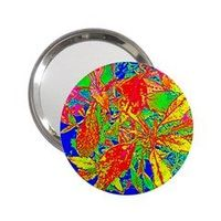 """A good companion to take with you in your handbag. Lightweight and small in size, mirror design is protected with a mylar cover to prolong its longevity. Measures approximately 2.25"""" diameter"""