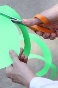 "Spiral Streamers �€"" DIY Party Decor: Take a sheet of heavyweight construction paper or card stock (8.5 by 11 inches is fine) and use scissors to round off the corners. Then start cutting the spiral. Begin from the outside edge and star..."