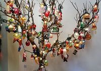 Glass light covers from Old World Christmas are a great way to fill in the blank spaces on your tree, by just slipping the light cover over the light bulb! Or do as we do and just display a whole tree of them!