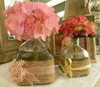 Wrap old bottles in twine and add ribbon for a vase
