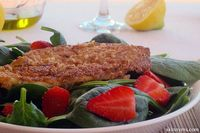 """Enjoy crunchy tilapia over a bed of baby spinach and fresh strawberries. You've probably heard, """"fish is brain food""""."""
