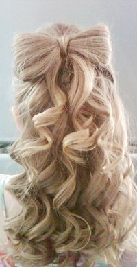 cute hair style! Wish I could do it!