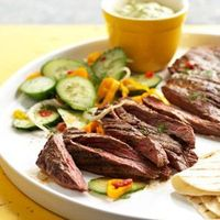 Spicy Skirt Steak with Avocado Dipping Sauce - For Avocado Dipping sauce, cut about 3 inches from cucumber and coarsely chop (reserve remaining for Cucumber Salad). Place in a food processor or blender. Add avocado, sour cream, dill, lime juice, j...