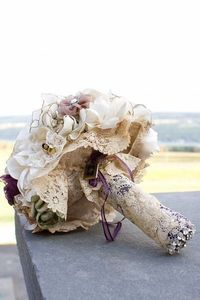 This bride took lace from her mother's wedding dress and wrapped it around her bouquet. there's so many ways to incorporate your mom on your wedding day.