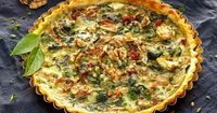 Our Spinach Quiche with Sun-Dried Tomatoes is packed with protein, a dose of essential amino acids, and vitamins like riboflavin and folic acid.