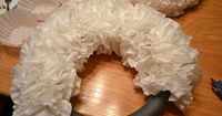 coffee filter wreath. Dye the coffee filters in water with food coloring to change it up.