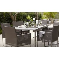 "Our urban style Dune collection is truly a modern ""indoor room"" that lives outdoors. Rectangular dining table tops out in pebbled glass with a contemporary look of stone in a sleek outdoor-grade stainless steel frame and seats six."