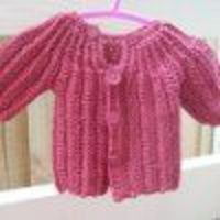 If you're looking for some simple crochet patterns, try this One Piece Baby Sweater. This little cuddly sweater is one large crocheted piece, so no extra assemb