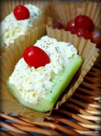 egg salad boats (egg salad stuffed in hollowed out cucumber pieces and topped with a cherry tomato)