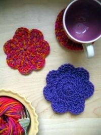 These simple, flower-shaped coasters are a great project for learning to crochet in the round.