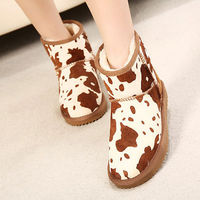 CONTRAST COLOR COW SKIN PRINT WARM SNOW BOOTS WATERPROOF FLAT SHOES Price:$51.99 Style: Sweet  Color: Black / Brown  Upper Material: Cowhide Lining Material: Man-made Short Plush  Outsole: Gum