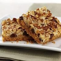 Magic Cookie Bars: 1/2 C butter or margarine, melted 1 1/2 C graham cracker crumbs 1 (14 oz) can EAGLE BRAND® Sweetened Condensed Milk 2 C semisweet chocolate morsels 1 1/3 C flaked coconut 1 C chopped nuts