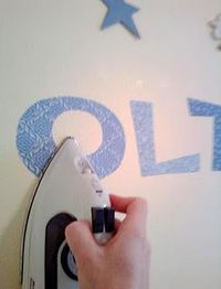 You can iron fabric right onto the wall ! Peels off better than vinyl!! Freakin sweet!!!