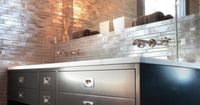 open-top pull-out towel drawers = genius! plus love for the gray taupe gold linear glass tiles backsplash walls