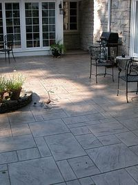 by Steve VandeWater So you'd like a new stamped concrete patio, but already have a plain gray one. Does your contractor need to tear yours out before installing the new concret...