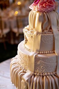Love the romantic draping on this stunning wedding cake!