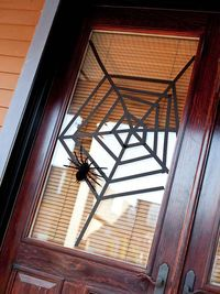 Webbed Window Covering - great idea with a little black tape. For more creative ideas: http://www.bhg.com/halloween/indoor-decorating/halloween-door-decor-28-great-ideas/#