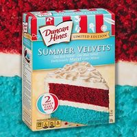One red velvet, one blue velvet, deliciously moist cake mixes.....just in time for 4th of July....frosting it with whip cream and topping with fresh strawberries and blueberries