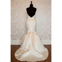 Sweetheart, low-back, mermaid gown. Would add a pretty embellished belt to give it a little sparkle.