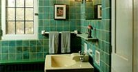 This vibrant bathroom highlights beautiful shades of teal on tiled walls, ceiling, and floor.