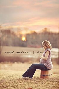Beautiful shot, evening sunset, maternity, old wooden pail to sit on