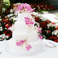 Carefully placed fresh orchids decorated the white buttercream cake., if we had daisys!