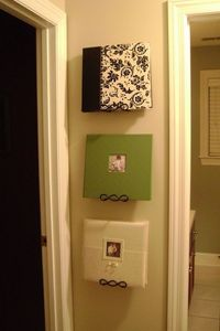 Use plates hangers to display photo albums. Family and friends can take and browse whenever they visit