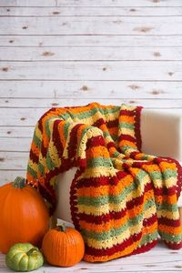 Autumn Fields Throw - Accessorize your couch or your bed with this bright and beautiful autumn throw. The Autumn Fields Throw is worked in rows in vivid fall hues and is sure to brighten up any room. From the October 2015 issue of I Like Crochet