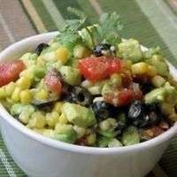 Cool, refreshing avocado slices are mixed with a marinated corn, olives, red pepper and onion salsa. Serve this south of the border flavor explosion with tortilla chips.