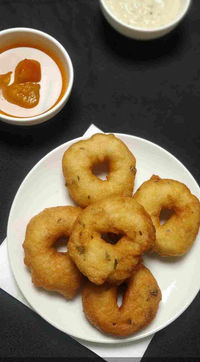 Medu vada is a popular breakfast served with sambar and coconut chutney and made from urad dal.