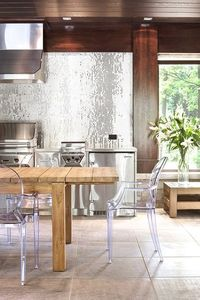 where to start? the dazzling back tile, the wood tones, the lucite chairs, the ginormous square tiles, the view...