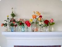 brightly colored flowers in jars. Something nice to do when you move into a new house and all your stuff is still in boxes.