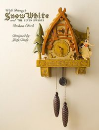 SNOW WHITE AND THE SEVEN DWARFS CUCKOO CLOCK Designed by Jody Daily Hand-carved wood construction. Metal chains and weights. Released in 2006. Limited Edition.