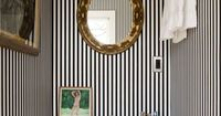 I use to have this paper in my bathroom, I miss it!! steven sclaroff. black & white striped powder room.