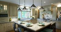 gourmet kitchen set in traditional style--Love the seating and the cabinets.