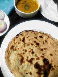 Tandoori roti is a unleavened flatbread made from whole wheat flour. Low calorie and useful for weightloss too.