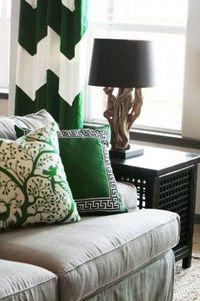 living room inspiration (gray sofa, black furniture, kelly accents...the curtains are fantastic.