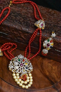 beautiful american diamonds navratna pendent set with real coral mala. $296.00