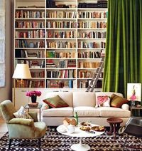 "#Living Room #Library Hide floor to ceiling #books and cabinets behind a tall green velvet drape. I like the painters ladder. This is a great way to hide ""stuff"" while keeping it classy."