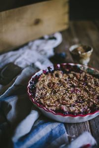 Late summer means lots and lots of fresh berries, and I've found that the best and simplest way to put them to use is in a good crisp. Even though it's toasty o