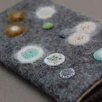 The artist in me is attracted to this lichen (or are they mold spores?) inspired crochet art by Elin Thomas.