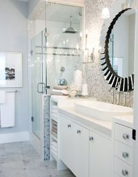 There is one word to define this master bathroom - GLAM. It's all about the details. Just look at the lighting fixtures. They resemble candelabras! And the beautifully-designed