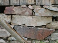 Bricks and stones hold up the old barn. Big stones and tiny stones, each stone has its place. I imagine that some stones were added as needed--small repairs ove
