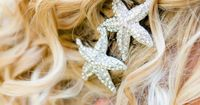 Starfish hair pins/brooches for a beach wedding. Starfish brooch available at http://www.yourweddingcompany.com/index.php/action/purchase/productId/188/categoryId/139/