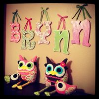 Kid's Decor / Letters -- Cheap & Easy Project -- I bought the wood letters at Hobby Lobby. Painted the edges with cheap craft paint. Traced and cut scrapbook paper and used Mod Podge to glue the paper on. Once it dried I coated the top of the pape...